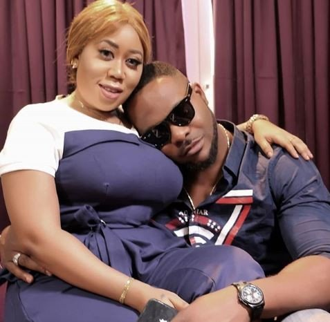 Actor Bolanle Ninalowo and Actress Moyo Lawal being playful on a movie set