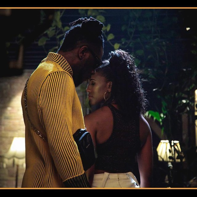 Burna Boy Shares Loved-Up Photo with Unknown Lady