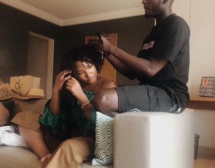 How Romantic! See Photo of Mr. Eazi Making his Girlfriend's Hair