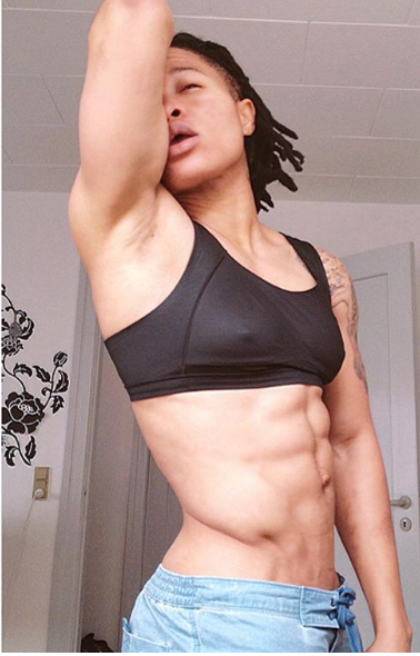Female footballer Chichi Igbo flaunts her six-packs in this photo