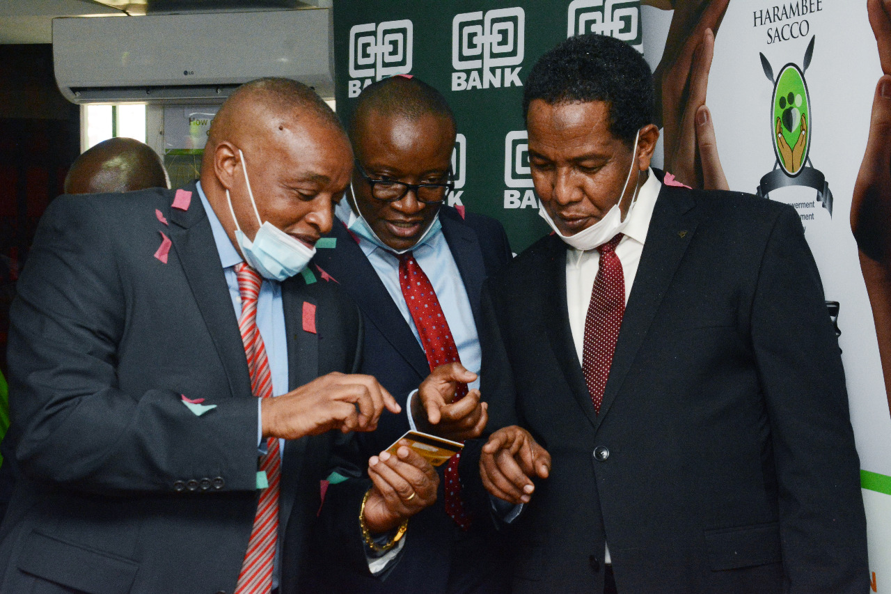 (L-R) The Chairman Harambee Sacco Macloud Malonza, the Director Cooperatives Banking at Co-op Bank Vincent Marangu and Principal Secretary, State Department for Cooperatives Ali Noor Ismail having a touch and feel at the very first debit card printed and issued instantly at the Sacco.