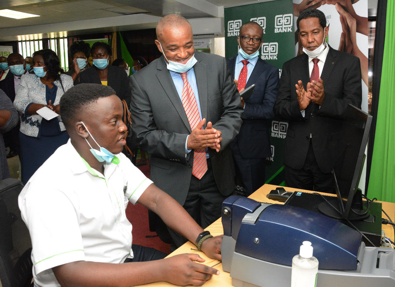 Kevin Mungere of Harambee Sacco demonstrates how instant printing of Sacco debit cards is done.