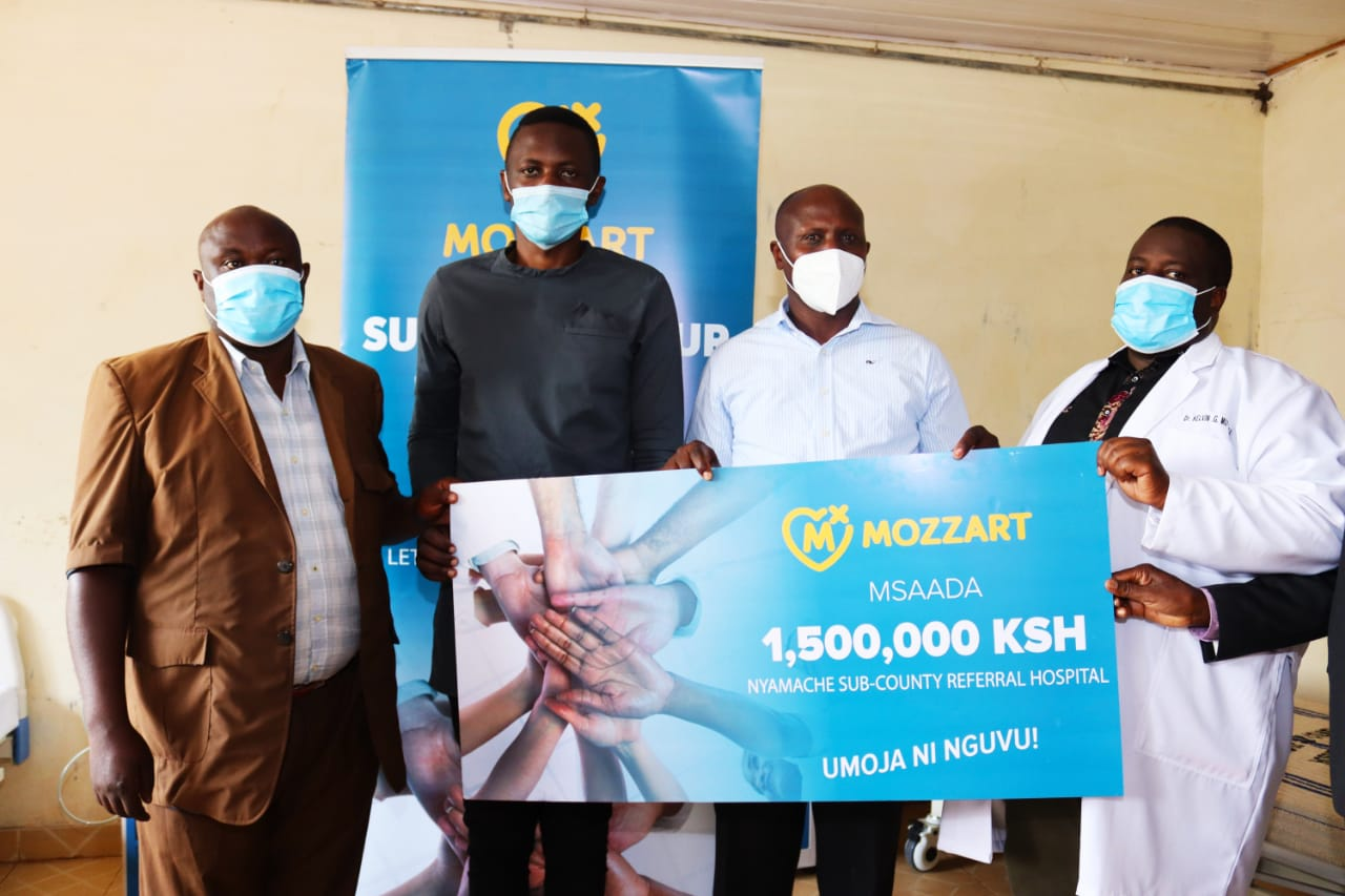 Medical staff at Nyamache Sub County Referral Hospital and Mozzart team pose with a dummy cheque during the event.