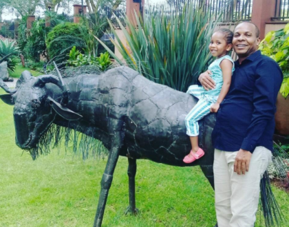 Danson Mungatana having fun with their youngest daughter